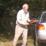 Bob Conway trims the driveway.