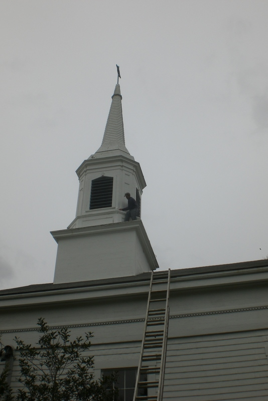 Roy Riley repairing flashing on Steeple