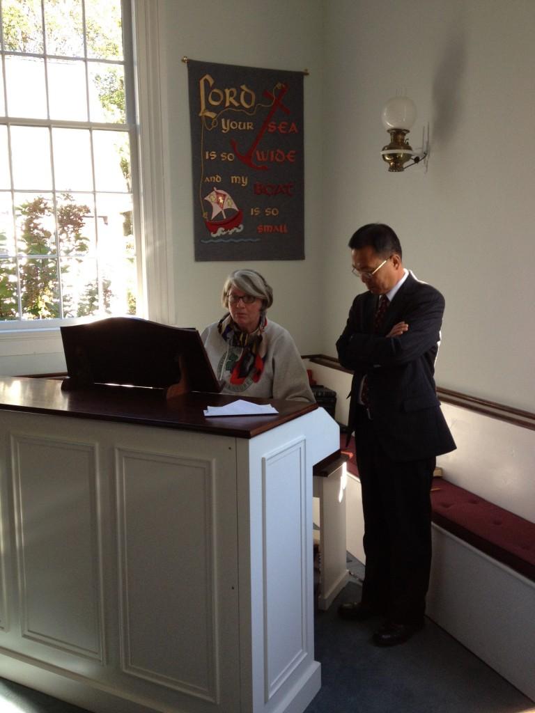 Lia Kahler shows D. S. Seok Hwan Hong the new organ.